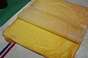Décollage le la feuille de papier sulfurisé